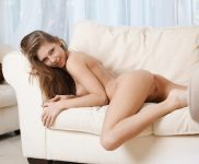 Anjelica naked on a couch
