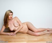 Amber poses naked on the floor
