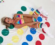 Nikki poses in a colorful bikini