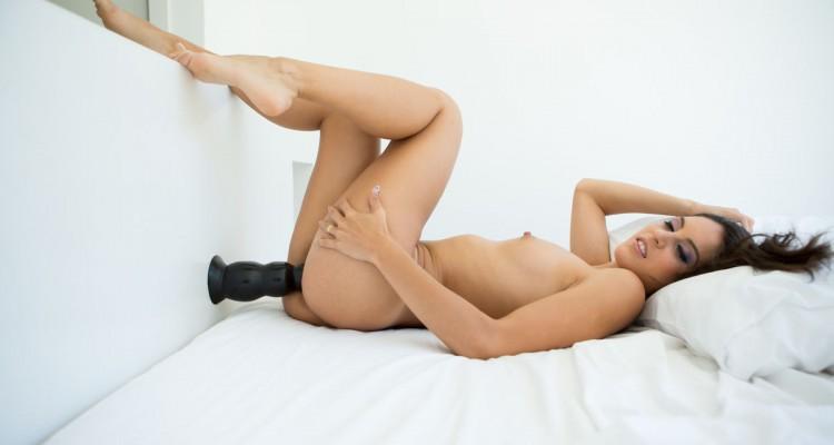 Carolina fucking herself with a big black dildo