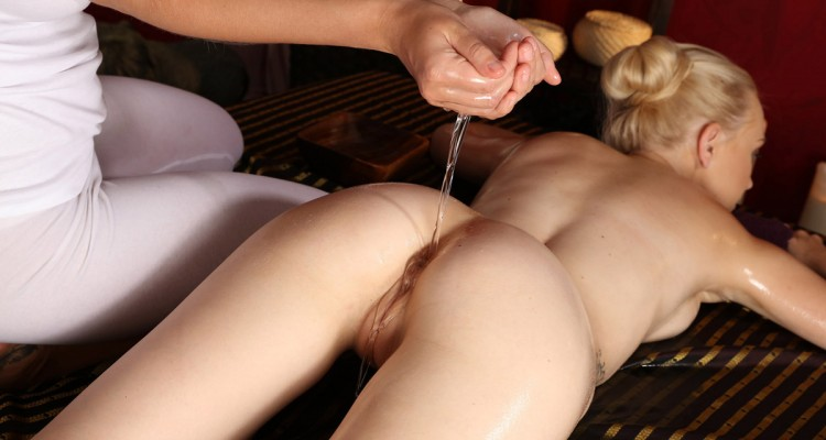 Lucy dripping oil into Debora's ass crack for her naughty massage