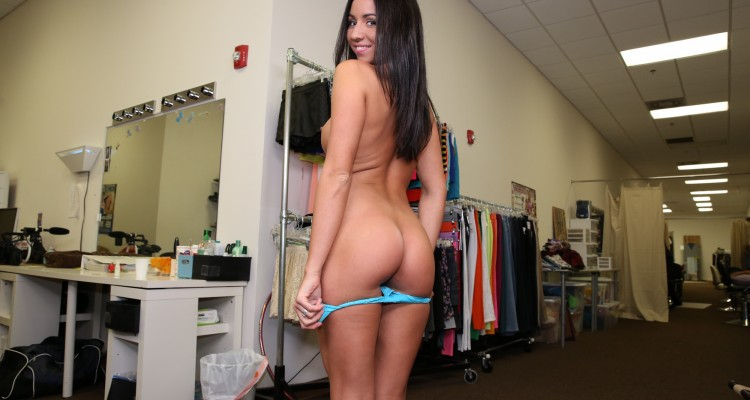 Brunette with an amazing ass gives a handjob