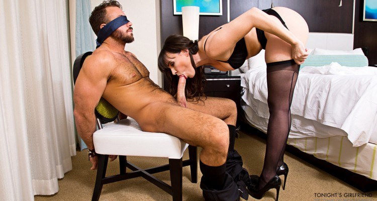 Dana DeArmond blows her blindfolded client