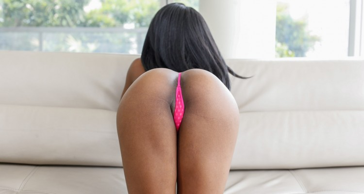Sarah Banks poses in a tiny pink thong