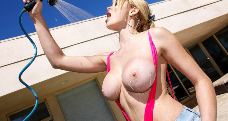 busty blonde showers with garden hose
