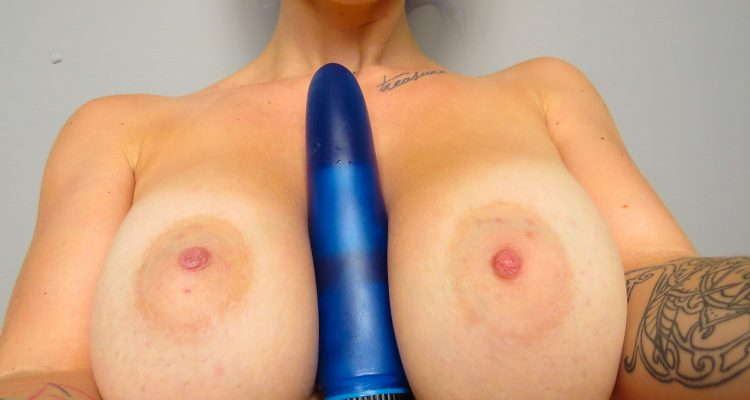 Vibrator between breasts